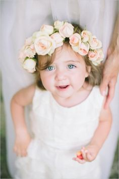 flower girl with roses in her hair