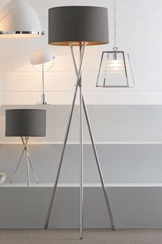 NEXT Chrome Tripod Floor Lamp £80. Chrome metal. With wool rich shade. We recommend an ES GLS 7W LED bulb 955-784 or a 42W halogen bulb 882-554.  H160 x Diameter 42 cm.