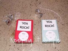 iPods | 21 Totally Adorable Homemade Valentines.... small box of conversation hearts covered with wrapping paper, floss and kisses for headphones. How cute !