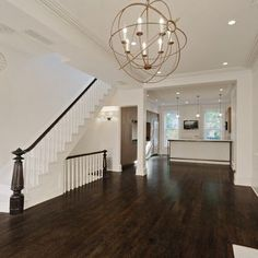 ceilings moldings and dark floors make this look classy and not TOO modern.
