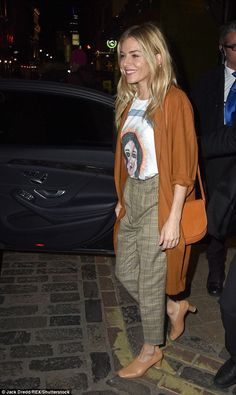 Looking good: Sienna Miller embraced the seasonal changes as she opted for a rust coloured cardigan which proved perfect for the autumn