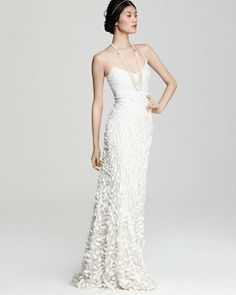Theia 880631. This light weight gown is adorned with petals that grow in size from top to bottom.