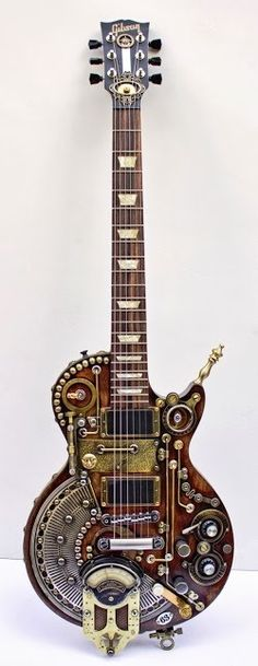 When I was a young college girl, I might have fallen in love with a boy who played this guitar. Gibson Guitar Steampunk Custom Made by Arte Steampunk, Steampunk Design, Steampunk Fashion, Steampunk Artwork, Unique Guitars, Custom Guitars, Vintage Guitars, Guitar Art, Music Guitar
