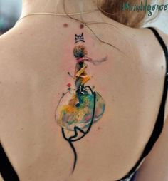 The narrow vertical tattoo along the spinal column is a common choice of ladies all over the world.