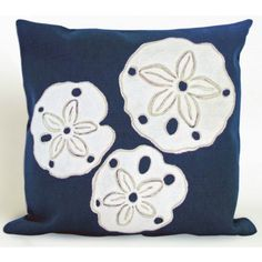 This navy and white pillow features three large white sand dollars that add a delightful beachy pop that's perfect for a coastal cottage or boat!