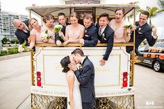 Wedding Photography Inspiration Picture Description Coronado Community Center wedding bride and groom kissing with the trolley and bridal party in the Vintage Wedding Photography, Wedding Photography Inspiration, Photography Ideas, Red Bouquet Wedding, Wedding Bridesmaid Dresses, Unique Wedding Hairstyles, Wedding Background, Chicago Wedding, Wedding Pictures