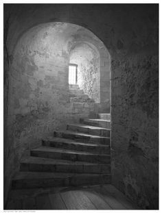 Paper: 16.5 x 12.5 Image: 16 x 12 Dramatic spiral staircase in a castle, with an ambient light from a window highlighting the texture and beauty of the architecture.