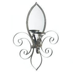 Fleur-De-Lis Mirrored Wall Sconce - A little French flair that will reflect your dazzling eye for design! This is truly a unique and beautiful candle sconce, with an iron frame and mirrored back, that will make a stylish statement on your wall. Add the candle of your choice.
