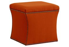 The now classic ottoman in a kicky color for spring.  I use these all the time when a room needs extra seating.