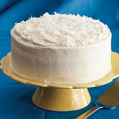 Lemon-Coconut Layer Cake --  classic layer cake featuring a tangy lemon filling between layers of tender white cake and topped with coconut-cream cheese frosting.