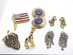 GROUPING OF COSTUME JEWELS FROM VINTAGE TO NEWER. INCLUDES SIGNED PIECES BY GIVENCHY, KENNETH JAY LANE, WEISS AND TRIFARI. THE BLUE RHINESTONE BROOCH IS MISSING A COUPLE OF STONES.