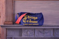 VINTAGE NEWSPAPER DELIVERY BAG, CHICAGO TRIBUNE MAIL BAG, MESSENGER BAG, PAPERBOY BAG  Thick navy blue canvas or duck cloth fabric. Yellow text.
