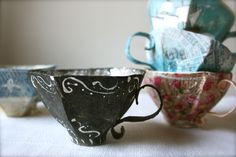 so delicate looking. here for tutorial: http://annwood.net/blog/2011/02/24/paper-mache-teacup-pattern/