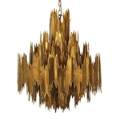 Large Brutalist Chandelier by Tom Greene for Feldman | From a unique collection of antique and modern chandeliers and pendants at https://www.1stdibs.com/furniture/lighting/chandeliers-pendant-lights/
