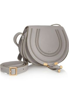 Gray textured-leather (Calf) Tab-fastening front flap Designer color: Cashmere Gray Comes with dust bag Weighs approximately 1.3lbs/ 0.6kg