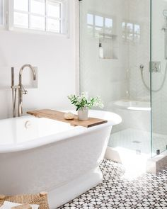 """Victoria + Albert Baths on Instagram: """"Our York bath looks right at home in this sunlight-filled bathroom by @evalarocqueinteriors. The natural accessories and simple white…"""" Relaxing Bathroom, Bathroom Inspo, Bathroom Interior, Bathroom Ideas, Victoria And Albert Baths, Washroom Design, Natural Accessories, Tile Layout, Modern Shower"""