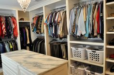 I LOVE my new closet! We converted a bedroom into our master bedroom closet. Designed by us, Mark & Laura Smith. Cabinets built by Brooke Colditz.