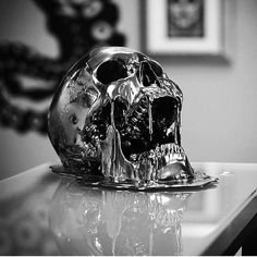 Great shot of this black chrome melting skull created by @jackofthedust. -- Photo Credit:@guardianartgallery -- #jackofthedust #skull #macabre #gothic #skeleton #skeletor #blacksails #sculpt #skulls #melting #chrome #terminator #artist #blackchrome #halloween #trickortreat