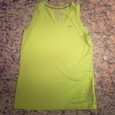 Large Nike Dri-fit regular fit sleeveless tee Large Neon green Nike Dri-fit regular fit sleeveless tee in EUC.  NO TRADES Nike Tops Muscle Tees