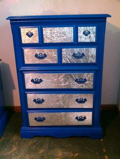 DIY. Dresser makeover...Behr Blueberry Twist paint, metallic blue spray paint handles, and wrinkled aluminum foil on drawer fronts.  #wickedawesomeproject