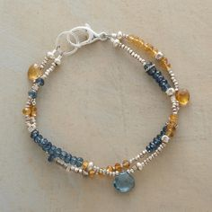 "BUTTERBLUE BRACELET -- Rondelles of butterscotch citrine and blue quartz populate this bracelet's two strands, accentuated with the occasional briolette. Exclusive. Handcrafted in USA. Sterling silver beads. 7""L."