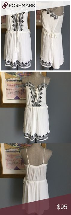 ❗️SALE❗️Embroidered Dress by Romeo + Juliet Totally fabulous ivory & navy dress from Romeo + Juliet Couture !  Features embroidered top part and at hem , tassel tie neckline , elastic waistband with side drawstring , adjustable straps and stretch back band , fringed hemline .  Fully lined .  Made of 100% rayon .  Lining made of 100% polyester . Romeo & Juliet Couture Dresses