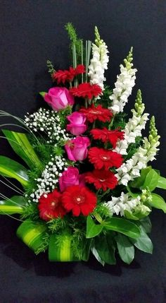 The arrangement is well balanced with red ,pink, and white. Unity of the arrangement is alright everything looks like it is in order. The pink and red stand out the most in this arrangement.