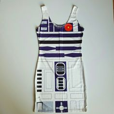 Star Wars R2D2 dress Super cute stretchy dress is Star Wars themed and it looks like the robot R2D2. The material is stretchy and made of polyester and spandex. Scoop neck tank top shoulder straps and bodycon, tight and body hugging. This is a brand new dress and never woren. Dresses