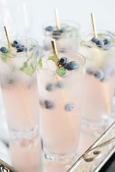 Signature cocktails with gold straws and fresh blueberries accent a French Blue Styled Shoot captured by Charlotte Wedding Collective wedding food French Wedding Inspiration - French Blue Styled Shoot Fancy Drinks, Cocktail Drinks, Yummy Drinks, Alcoholic Drinks, Beverages, Johnson Baby, Party, Wedding Inspiration, Bon Appetit