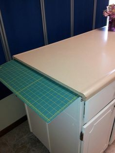 Cutting board fits under countertop for storage Kitchen Cupboards, Kitchen Sink, Low Cabinet, Countertops, Cutting Board, Old Things, Sewing, Storage, Room