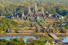 Aerial view of Angkor Wat, showing the moat and causeway and the central tower surrounded by four smaller towers
