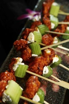 Bite-Size Buffalo Wings with Bleu Cheese & Celery on Toothpicks | Photography: KingenSmith. Read More: http://www.insideweddings.com/weddings/interfaith-candlelit-ceremony-glamour-purple-reception/370/