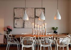 great combination of sculpturual chairs, contemporary wood pieces and lighting, warmed up by the vintage tin  from  desiretoinspire.net