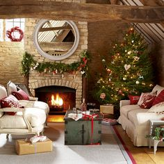 Country living room, like the fireplace and rustic wood