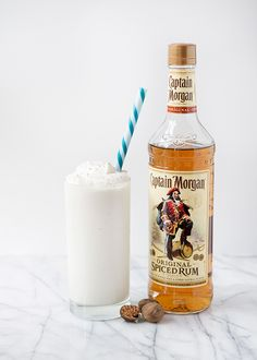 Coconut Rum Shakes-1 pint coconut sorbet,  1 pint vanilla ice cream, 3/4 - 1 c. Spiced Rum, whipped cream, freshly grated nutmeg.Add the coconut sorbet  vanilla ice cream to a blender. Add about 3/4 cup Rum.Give it a whirl and add more rum if you need to thin it out. Pour into a glass and top with homemade whipped cream and grate some nutmeg over the top