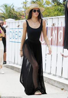 Black sheer: Separating herself from the pack entirely was 19-year-old Kendall, who donned a sheer black skirt and matching one-piece swimsuit for the day in the sun