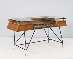 OSVALDO BORSANI Unique and important desk, with ceramic by Aligi Sassu, 1955  Molded and laminated birch plywood, glass, painted metal, glazed ceramic, bronze.Manufactured by Tecno, Italy. 31 3/4 x 57 x 22 1/2 in. (80.6 x 144.8 x 57.2 cm)