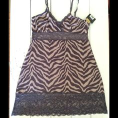 "Zebra Print Babydoll Nightie Super sexy and flirty nightie. Straps are adjustable, lace strip under the bust and at bottom of skirt. Pattern is a dusty pink with purple zebra stripes. Fabric is very stretchy and comfortable. Brand is Marilyn Monroe. Size is XL, would fit a size 12 / 14 with a B or C bust.  Measurements, lying flat then doubled: Bust: 33"" Under bust: 31"" Hip: 47"" Total length: 26"" Warners Intimates & Sleepwear Chemises & Slips"