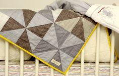 Windmill baby quilt by http://quiltingstories.blogspot.com/2015/04/windmill-grey-baby-quilt-finished.html