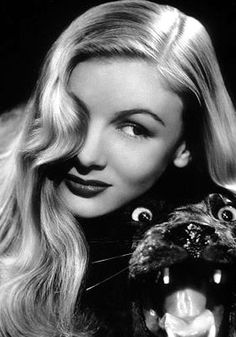 Veronica Lake. An American film actress and pin-up model. Veronica Lake's peekaboo wave hiding one eye added to the cool blonde's mystery.