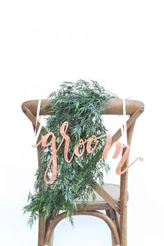 Copper leaf bride and groom calligraphy wedding chair signs by Hostandtoaststudio via etsy. #reception #weddingchairsigns