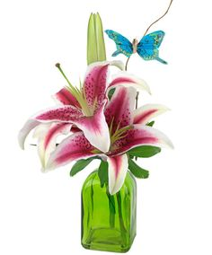 Bottle Blossoms - Stargazer Lily-Gorgeous, fragrant stargazer lilies are arranged in a small, sweet bottle. Bloom color will vary, and the vase will be green. #ZeidlersFlowers #EvansvilleFlowers #AdministrativeProfessionalsWeek