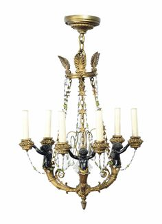 A GILT AND PATINATED-BRONZE FIGURAL SIX-LIGHT CHANDELIER, 20TH CENTURY.
