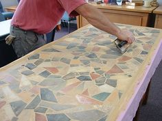 Do it Yourself Mosaic Tables. I should!