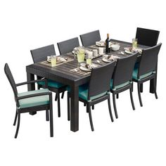 Perfect for dinners and family game nights on the patio or by the pool, this stylish indoor/outdoor dining set features 2 arm chairs, 6 side chairs, and a co...