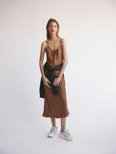 We designed considered silk pieces for women of style and purpose. Elevate your wardrobe with quality essentials. Shop soft suiting and silk slip dresses. Sports Luxe, Laundry, Normcore, Slip On, Silk, Slip Dresses, Hangers, Clothes, Campaign