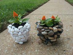 River rocks, or glass marbles, glued to flower pots