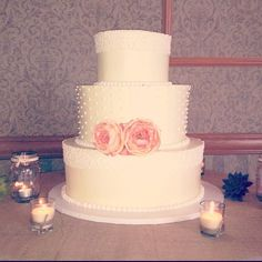 Rustic Wedding Cake with Three Tall Tiers, Pink Peonies, Burlap Cloth, Mason Jars, & Succulents.