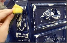 This is gorgeous. Paint base coat. When dry, apply Vaseline to trim pieces & details. Then paint in contrasting color with sprayer. Will crackle and resist Vaseline as it dries. Scrub with an old scrubby sponge.