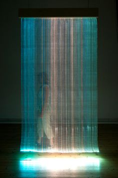 Astrid Krogh - Light Tapestries   This artist is experimenting with light and its relationship with textiles through installation work. I would like to see how I can apply this to garments.